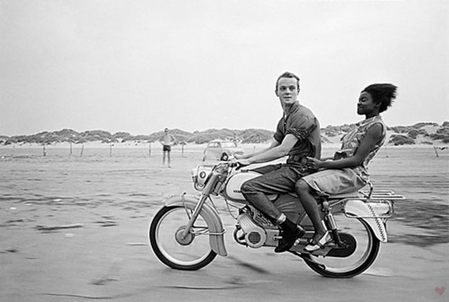 vintage couple motorcycle riding beach