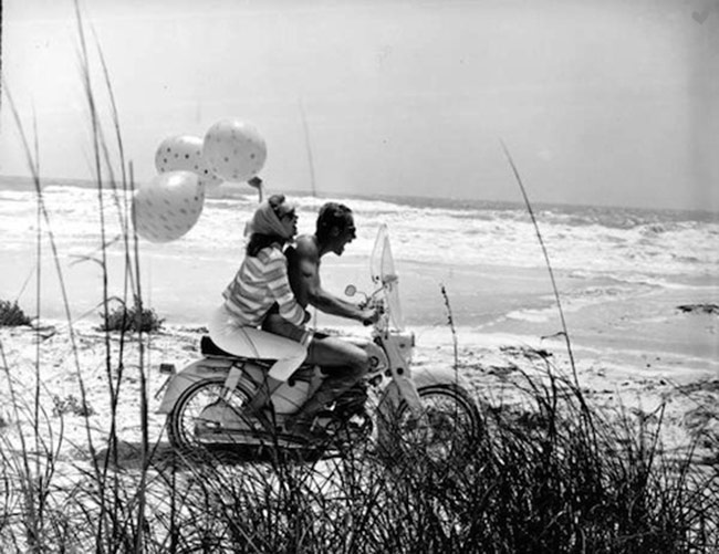 vintage motorcycle couple beach