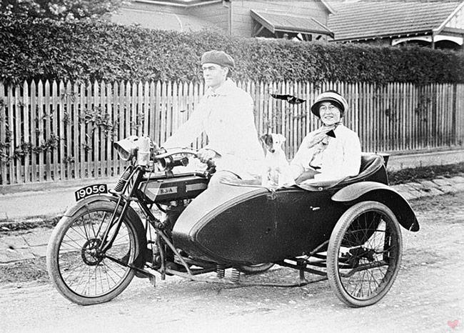 vintage motorcycle sidecar couple BSA