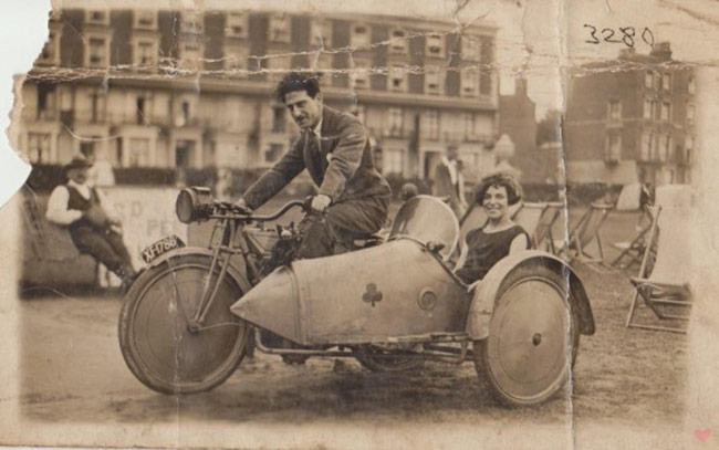 vintage sidecar motorcycle couple