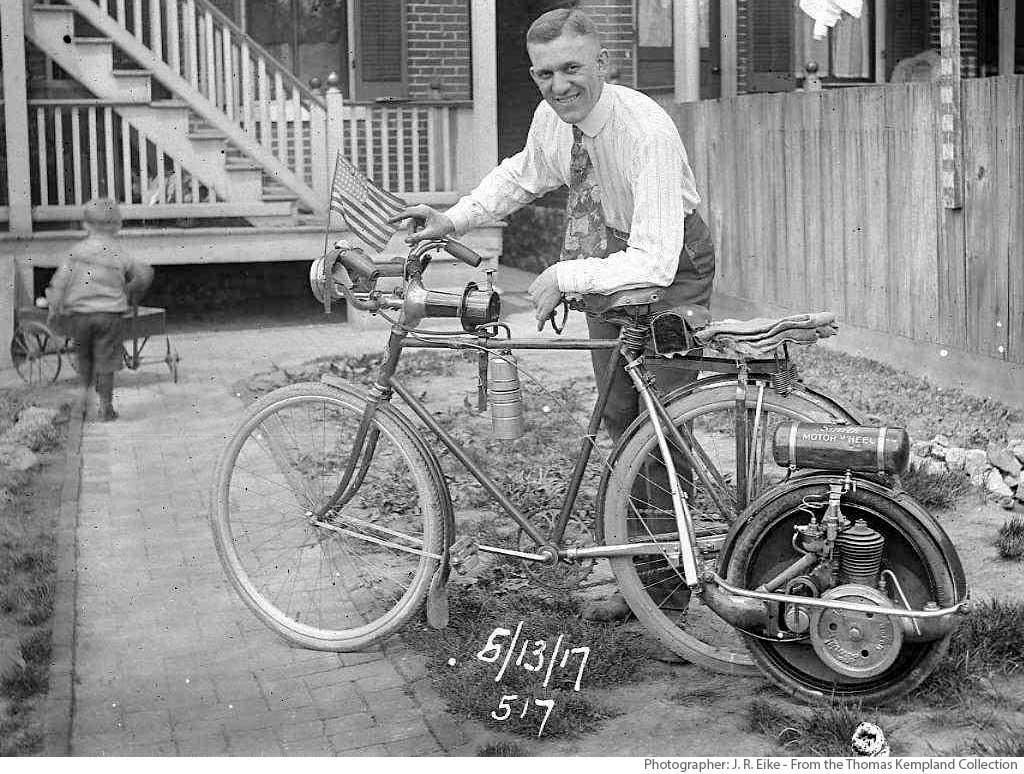J.R. Eike and a Smith Motor Wheel